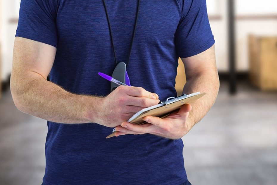CrossFit Gym Owner Writing in notebook